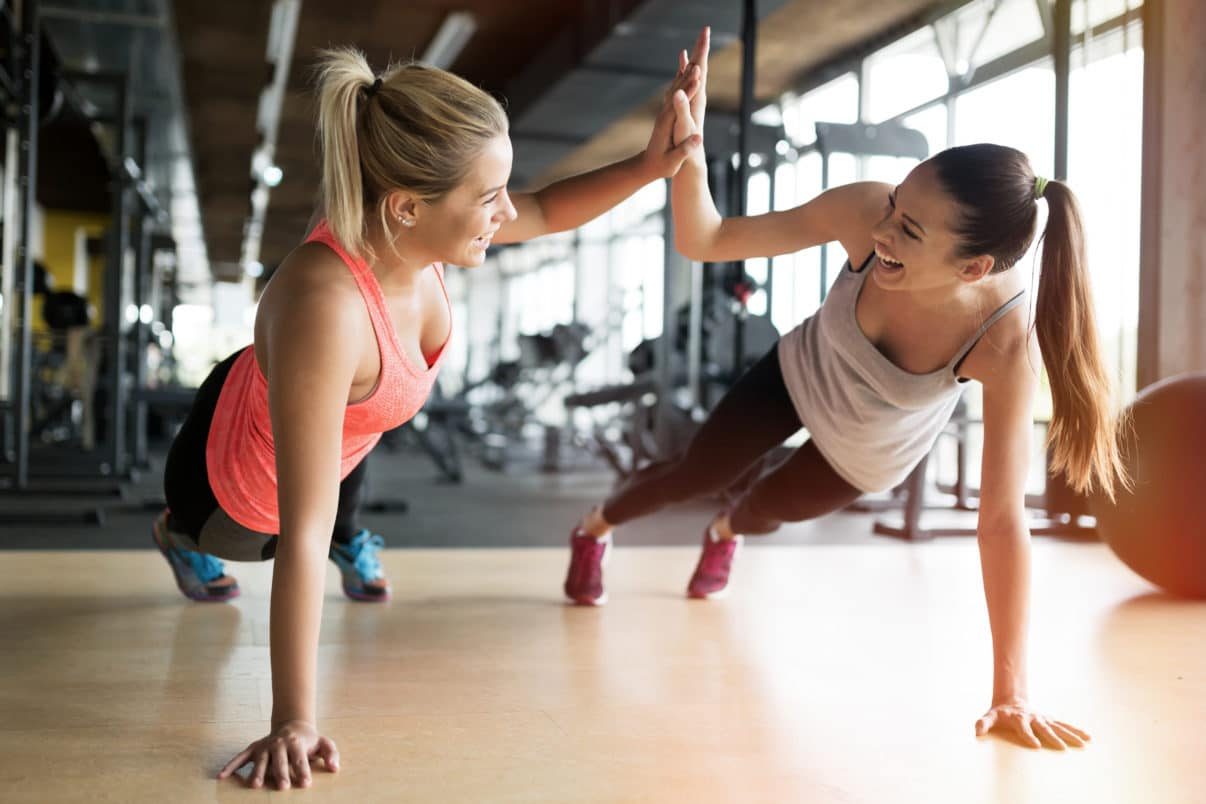 Two women being fit together