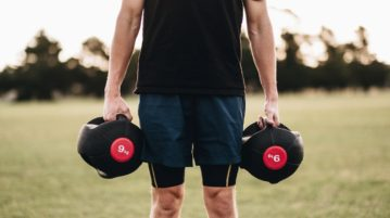 Person holding dumbells