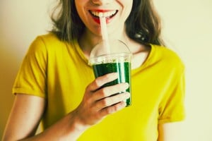lady drinks green smoothie