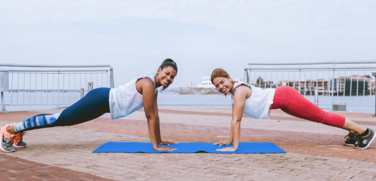 two woman doing push up