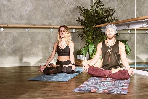male and female doing yoga