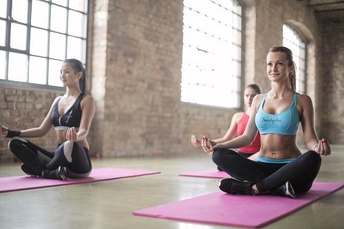 three woman doing yoga
